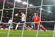 Goal - Dominic Solanke of England U21's takes the ball around goalkeeper Florian Muller of Germany U21's to score a goal to make the score 1-1 during the U21 International match between England and Germany at the Vitality Stadium, Bournemouth, England on 26 March 2019.