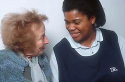 Elderly woman talking to carer,