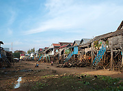 The central 'street' at low tide in summer of the floating village of Kompong Phluk on the great Tonlé Sap lake, Cambodia