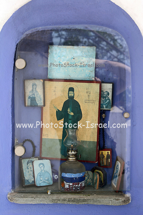 Greece, Thessaly, Agia Kiriaki, a little fishing village at the south west point of the peninsula Pelion A religious icon at the entrance to a house