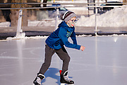 03 JANUARY 2021 - DES MOINES, IOWA: A child ice skates at Brenton Skating Plaza in downtown Des Moines. The ice skating rink usually opens in late November and stays open through late February or March, depending on weather. Covid restrictions limited capacity to less than half, skaters were encouraged to social distance, and skaters were required to wear proper face masks. This year the rink was forced to close January 3, after only six weeks, because it wasn't possible to comply with COVID-19 restrictions and still be profitable. Restrictions caused by the Coronavirus pandemic have limited many public events this winter in Iowa.    PHOTO BY JACK KURTZ