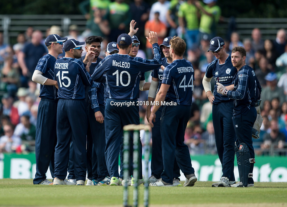 EDINBURGH, SCOTLAND - JUNE 12: Scottish players celebrate a wicket during the International T20 Friendly match between Scotland and Pakistan at the Grange Cricket Club on June 12, 2018 in Edinburgh, Scotland. (Photo by MB Media/Getty Images)