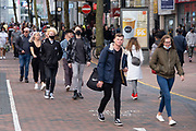 As numbers of Covid-19 cases in Birmingham have dramatically risen in the past week, increased lockdown measures have been announced for Birmingham and other areas of the West Midlands, people out in the shopping district wearing face masks on New Street in the city centre on 12th September 2020 in Birmingham, United Kingdom. With the rule of six also being implemented the Birmingham area has now be escalated to an area of national intervention, with a ban on people socialising with people outside their own household, unless they are from the same support bubble.