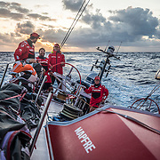 Leg 4, Melbourne to Hong Kong, day 15 on board MAPFRE, Louis Sinclair, Guillermo Altadill, Rob Greenhalgh and Tamara Echegoyen during the sunrise . Photo by Ugo Fonolla/Volvo Ocean Race. 15 January, 2018.