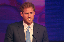 Prince Harry delivers a speech as he attends the WellChild Awards in London. The awards recognise the courage of seriously ill children, their families and carers.