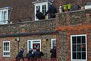 Police crews are storming into the house of the man who is alleged to have assaulted members of the public and emergency worker in south London on Tuesday, Aug 18, 2020, would come out and attack them before he surrenders. <br /> Members of the MET police crew stormed into his barricaded doorstep after Martin wouldn't respond to their multiple calls to surrender as he was declared that he was going to be arrested.<br /> After breaking the door police stumbled into a barricade made of a ladder, washing machine, several chairs and other wood and plastic items. After forcing themselves into his apartment, police couldn't find him. The search is on-going. (VXP Photo/ Vudi Xhymshiti)