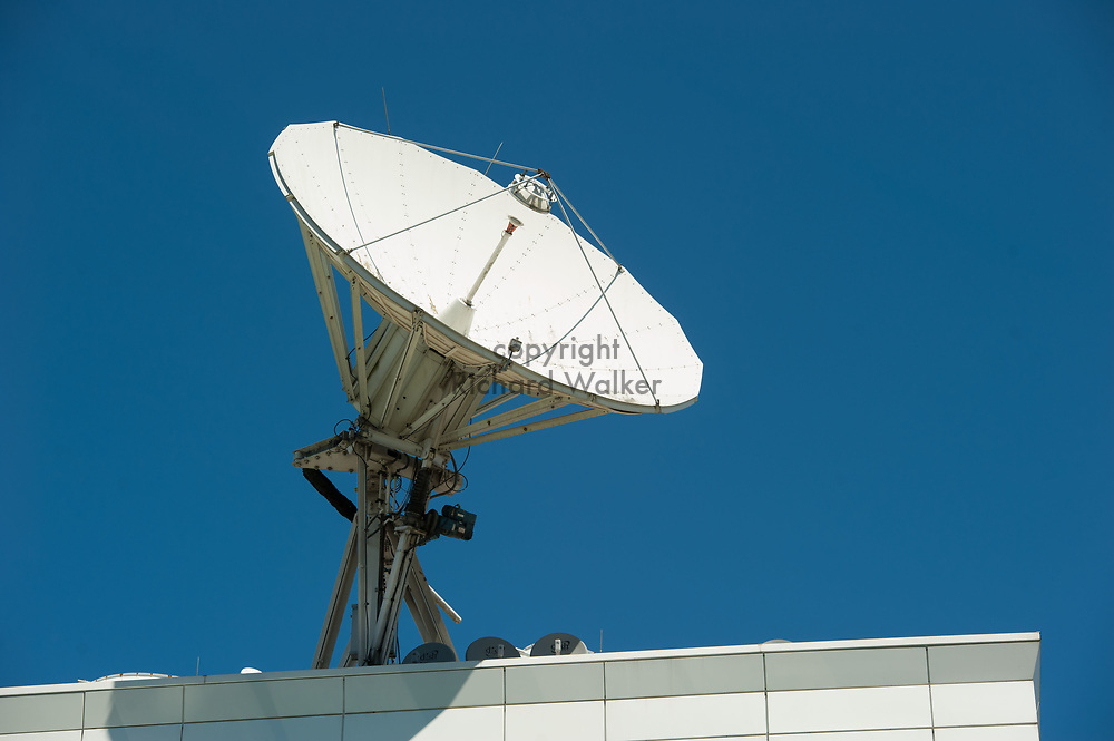 2017 JULY 25 - A satellite antenna dish against a blue sky on the roof of KOMO Plaza in Seattle, WA, USA. By Richard Walker