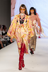 © Licensed to London News Pictures. 07/06/2016. London, UK. A model presents a look by Som Kerdsiri from Edinburgh University.  Graduate Fashion Week, day three, takes place at the Old Truman Brewery in East London.  The event showcases the work of over 1,000 of the very best graduates from over 40 universities around the world through 22 catwalk shows and more.  Photo credit : Stephen Chung/LNP