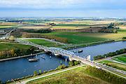 Nederland, Zeeland, Zeeuws-Vlaanderen, 19-10-2014; Sluiskil, Kanaal Gent-Terneuzen, kanaalkruising Sluiskil. <br /> De brug in de N61 sluit zeer regelmatig voor zeeschepen en dit veroorzaakt files. Daarom zal de kanaalbrug vervangen worden door een tunnel, de Sluiskiltunnel (oplevering 2015).<br /> The pivot bridge over the canal Gent-Terneuzen (Zeeland) closes very regularly for seagoing vessels and this causes traffic jams. Therefore, the canal bridge will be replaced by a tunnel, the tunnel Sluiskil (completion 2015).<br /> luchtfoto (toeslag op standard tarieven);<br /> aerial photo (additional fee required);<br /> copyright foto/photo Siebe Swart