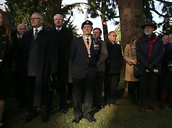 Gerry Crozier (centre), 2nd Royal Tank Regiment, joins members of Glasnevin Trust at a Wreath Laying ceremony to commemorate Armistice Day at the Glasnevin cemetery in Dublin.