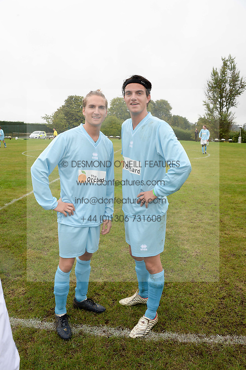 Left to right, OLLIE PROUDLOCK and VISCOUNT ERLEIGH at the Ripley Football Tournament hosted by Irene Forte in aid of The Samaritans held at Ryde Farm, Hungry Hill Lane, Ripley, Surrey on 14th September 2013.  After the football guests enjoyed an after party.