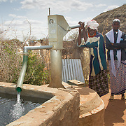 Community elders demonstrate a new pump-operated well in action. Wajir, North Eastern Kenya.