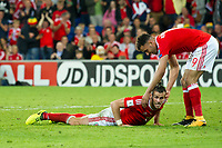 Football - 2017 / 2018 _Wales v Austria_FIFA World Cup Qualifier 2018<br /> <br /> Gareth Bale of Wales is helped up by Hal Robson-Kanu of Wales after attempting an overhead volley at goal--- at Cardiff City Stadium.<br /> <br /> COLORSPORT/WINSTON BYNORTH
