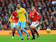 Damien Delaney of Crystal Palace and Robin van Persie of Manchester United in action - Manchester United vs. Crystal Palace - Barclay's Premier League - Old Trafford - Manchester - 08/11/2014 Pic Philip Oldham/Sportimage