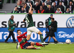 WOLFSBURG, Oct. 21, 2018  Bayern Munich's James Rodriguez (Bottom) vies with Wolfsburg's Robin Knoche during a German Bundesliga match between Wolfsburg and Bayern Munich, in Wolfsburg, Germany, on Oct. 20, 2018. Bayern Munich won 3-1. (Credit Image: © Xinhua via ZUMA Wire)