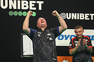 Glen Durrant wins the 2020 Premier League final against Nathan Aspinall and celebrates during the Unibet Premier League Play-Offs at the Ricoh Arena, Coventry, England on 15 October 2020.