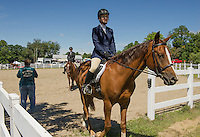 """Emily Maguire of Franklin leads her horse """"Cody"""" a Quarterhorse Arabian out of the ring following the Senior Equitation at the Belknap County 4H Fair Saturday morning.  (Karen Bobotas/for the Laconia Daily Sun)"""
