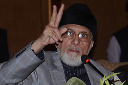 June 16, 2017 - Lahore, Punjab, Pakistan - Dr. TAHIR-UL-QADRI, Pakistani politician and Islamic scholar of Sufism, head of  Pakistan Awami Tehreek (PAT) and founding chairman of Minhaj-ul-Quran, talking to media persons during a press conference against the government at a local hotel. (Credit Image: © Rana Sajid Hussain/Pacific Press via ZUMA Wire)