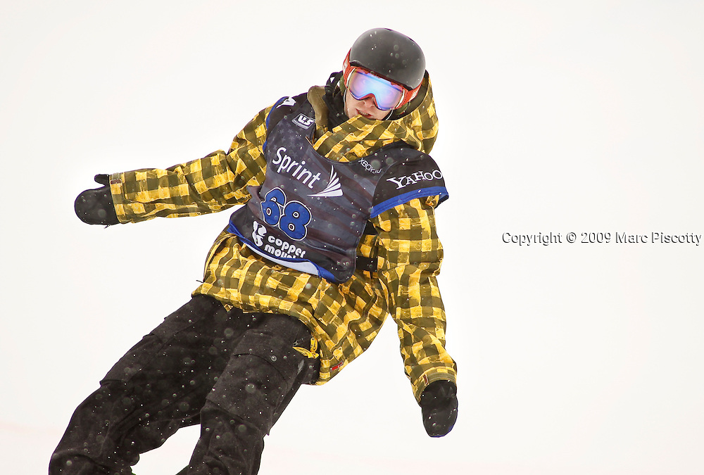 SHOT 12/12/09 12:49:01 PM - Snowboarder Jack Mitrani finishes his run during finals at the U.S. Snowboarding Grand Prix in the halfpipe at Copper Mountain on Saturday December 12, 2009. Shaun White, Louie Vito and Zachary Black finished on the podium on the men's side while Kelly Clark, Gretchen Bleiler and Soko Yamaoka grabbed the top three spots on the women's side. Mitrani finished tenth at the event. The competition was the first of three events that will be used to select the U.S. Snowboarding Team for the upcoming Winter Olympics in Vancouver. (Photo by Marc Piscotty / © 2009)