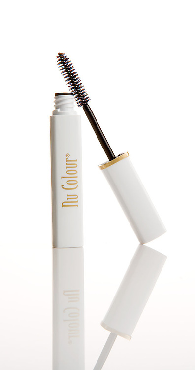 Catalog Pictures of Nu Color Mascara for Nu Skins product. On white plexiglass