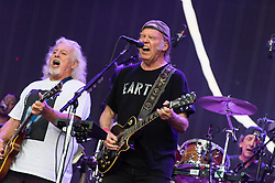 """© Licensed to London News Pictures. 12/07/2014. London, UK.   Neil Young and Crazy Horse performing live at Hyde Park as part of the British Summer Time series of outdoor concerts.In this picture - Neil Young (centre), Frank Sampredo (left), Ralph Molina (right).   Crazy Horse is a rock band long associated with Neil Young,  consisting of members Rick Roses, (bass, vocals), Ralph Molina (drums, vocals), Frank """"Poncho"""" Sampedro ( guitar, organ, keyboards).  Photo credit : Richard Isaac/LNP"""