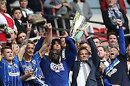 Neal Ardley lifting the trophy alongside Andy Bayles, Ade Akinfenwa, Paul Robinson, Jake Reeves during the Sky Bet League 2 play off final match between AFC Wimbledon and Plymouth Argyle at Wembley Stadium, London, England on 30 May 2016.