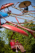 Children on a carnival ride during a country fair in St. George, SC