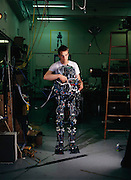 Dan Paluska, the mechanical engineering grad student leading M2's hardware design and construction, is seen here in a double exposure that melds him with his machine for a photo illustration. The lower torso and extremity robot, called M2, took its first tentative steps last year here in the basement of MIT's Leg Laboratory. Established in 1980 by Marc Raibert, the Leg Lab was home to the first robots that mimicked human walking; swinging like an inverted pendulum from step to step. Similar to image published on the cover of Wired Magazine, September 2000. MIT Leg Lab, Cambridge, MA.