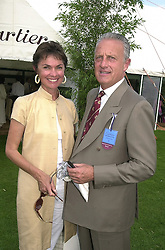 VIRGINIA, LADY WHITE and French jeweller MR MICHEL ERMALIN-BATTISTINI, at a polo match in Berkshire on 30th July 2000.OGN 187