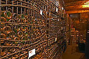 The private bottle aging cellar with hundreds, thousands of bottles in metal wrought iron cages aging. Bodega Juanico Familia Deicas Winery, Juanico, Canelones, Uruguay, South America