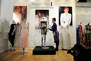 The see-through knitted dress modelled by Kate Middleton at the annual St Andrew's University charity fashion show in 2002, is displayed at an auction house, in London the day before it is auctioned.