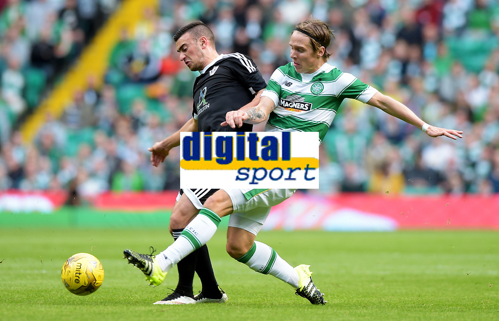 29/07/15 UEFA CHAMPIONS LEAGUE 3RD RND QUALIFIER 1ST LEG<br /> CELTIC v QARABAG FK<br /> CELTIC PARK - GLASGOW<br /> Celtic's Stefan Johansen (right) tackles Gara Garayev
