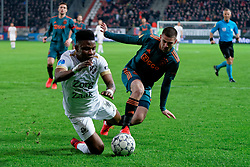 Issah Abass #21 of FC Utrecht and Razvan Marin #18 of Ajax in action during the semi final KNVB Cup between FC Utrecht and Ajax Amsterdam at Stadion Nieuw Galgenwaard on March 04, 2020 in Amsterdam, Netherlands
