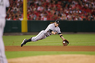 CHICAGO - OCTOBER 15:  Joe Crede #24 of the Chicago White Sox dives and snares a shot by Vladimir Guererro in the sixth inning during Game 4 of the American League Championship Series against the Los Angeles Angels of Anaheim at Angels Stadium on October 15, 2005 in Anaheim, California.  The White Sox defeated the Angels 8-2.