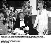 Marvin Davis at the Vanity Fair Oscar Night Party. Diane von Fursterberg with camera. Barbara Davis on right.1997 Mortons, Los Angeles 24 March 1997. 97752/19 (color original)<br /><br />© Copyright Photograph by Dafydd Jones<br />66 Stockwell Park Rd. London SW9 0DA<br />Tel 0171 733 0108
