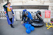 Anti-Brexit protesters wearing European Union flags with an inflatable black swan outside the Cabinet Office in Westminster on 17th September 2019 in London, England, United Kingdom. The swan signifies Operation Black Swan which refers to the worst-case-scenario planning for a No deal Brexit.