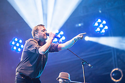 Guy Garvey of Elbow headlinee the Radio 1 stage Saturday, T in the Park 2014.<br /> © Michael Schofield.