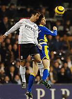 Photo: Daniel Hambury.<br />Fulham v Tottenham Hotspurs. Barclays Premiership. 31/01/2006.<br />Fulham's Carlos Bocanegra and Tottenham's Grzegorz Rasiak battle.