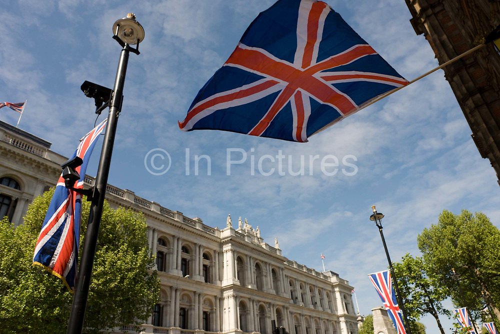 A Union Jack flag flies on a street light pole in Whitehall, days before the royal wedding ceremony of Prince William and Kate Middleton. The building in the background houses governmental offices, the seat of British government and democracy and the spring weather brings blue skies to the capital as the nation prepares to celebrate the state occasion.