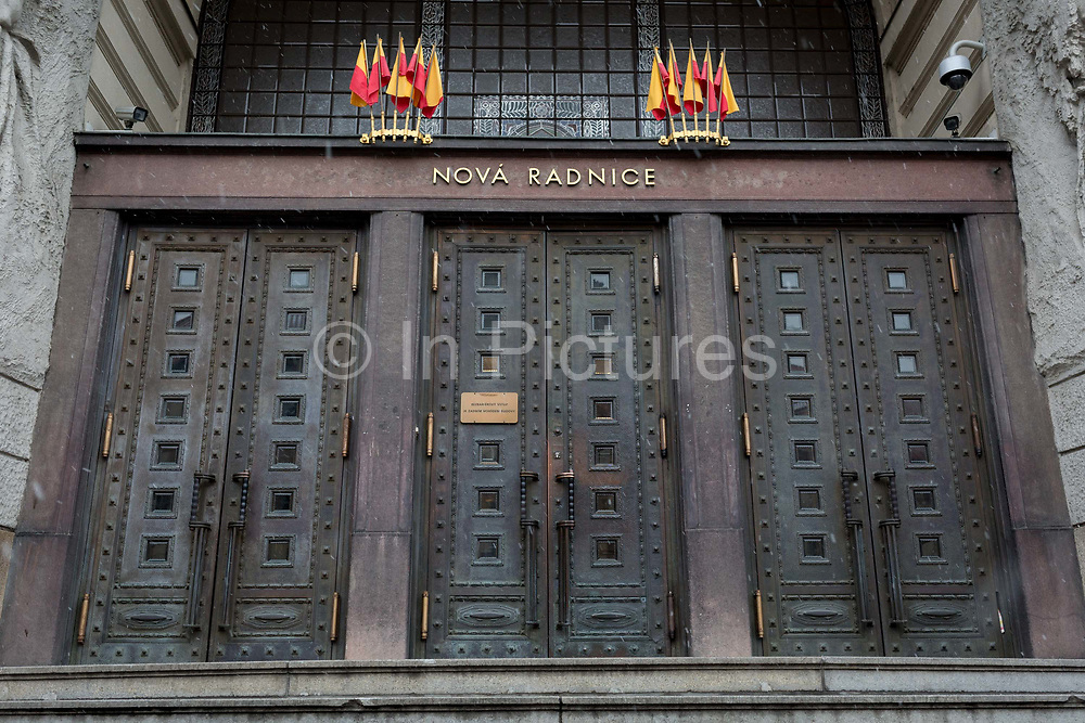 Closed heavy doors of Pragues New City Hall, on 17th March, 2018, in Prague, the Czech Republic. Prague New City Hall is located on the east side of Marianske namestí Virgin Mary Square in the center of the Old Town Prague 1 across from the Clementinum building complex. Since 1945 it is a seat of Prague City Hall and the mayor of the City of Prague. The building contains formal residences for the mayor and other city officials.