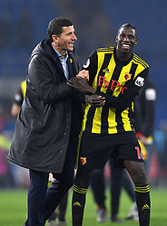 Watford manager Javi Gracia (left) and Abdoulaye Doucoure celebrate after the final whistle during the Premier League match at the Cardiff City Stadium.