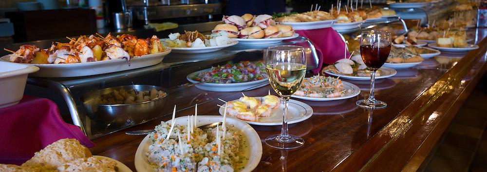 Tapas raciones in Taberna La Cierbanata  bar in tourist resort of Castro Urdiales in Cantabria, Spain