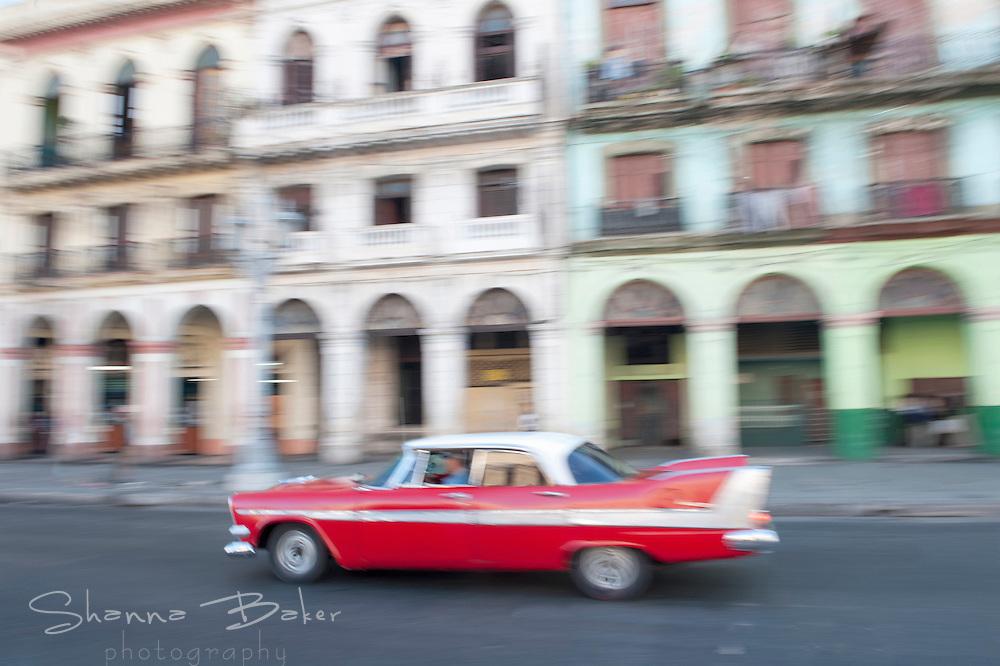 Old car blurring through the streets of Havana, Cuba