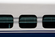 Abtract image of windows on a JR 700 Shinkansen as it leaves Shin-Yokohama station,Japan August 14th 2008