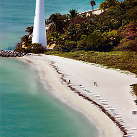 Aerial-Cape Florida Lighthouse, Key Biscayne, Florida.  Bill Baggs Cape Florida State Park is the home of the historic lighthouse built in 1825 and reconstructed in 1846, and is the oldest standing structure in Miami-Dade County.