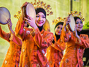 02 DECEMBER 2014 - BANGKOK, THAILAND: Dancers from Brunei perform during an ASEAN exhibit at the Trooping of the Colors military parade on Sanam Luang in Bangkok. The Thai Royal Guards parade, also known as Trooping of the Colors, occurs every December 2 in celebration of the birthday of Bhumibol Adulyadej, the King of Thailand. The Royal Guards of the Royal Thai Armed Forces perform a military parade and pledge loyalty to the monarch. Historically, the venue has been the Royal Plaza in front of the Dusit Palace and the Ananta Samakhom Throne Hall. This year it was held on Sanam Luang in front of the Grand Palace.    PHOTO BY JACK KURTZ