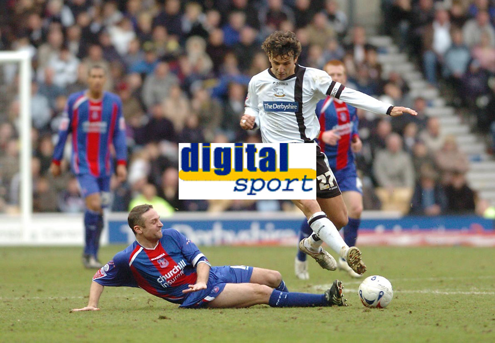 Photo: Leigh Quinnell.<br /> Derby County v Crystal Palace. Coca Cola Championship. 25/03/2006. Derbys Inigo Idiakez jumps a challenge from Palaces'  Michael Hughes.