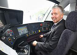 London Transport Commissioner Mike Brown sits in the drivers seat of an Elizabeth Line train as it enters service travelling from Liverpool Street station in London to Shenfield in Essex.