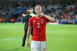 5LILLE, FRANCE - Friday, July 1, 2016: Wales Chris Gunter celebrates the 3-1 victory over Belgium at full time after the UEFA Euro 2016 Championship Quarter-Final match at the Stade Pierre Mauroy. (Pic by Paul Greenwood/Propaganda)