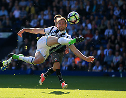 8 April 2017 - Premier League - West Bromwich Albion v Southampton - Craig Dawson of West Bromwich Albion acrobatically shoots only to see it saved by Fraser Forster of Southampton - Photo: Paul Roberts / Offside